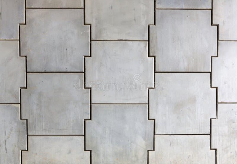 Muro de cemento que se enclavija imagenes de archivo
