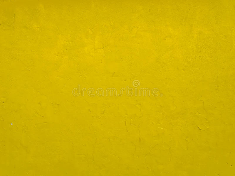 Muro de cimento amarelo fotografia de stock royalty free