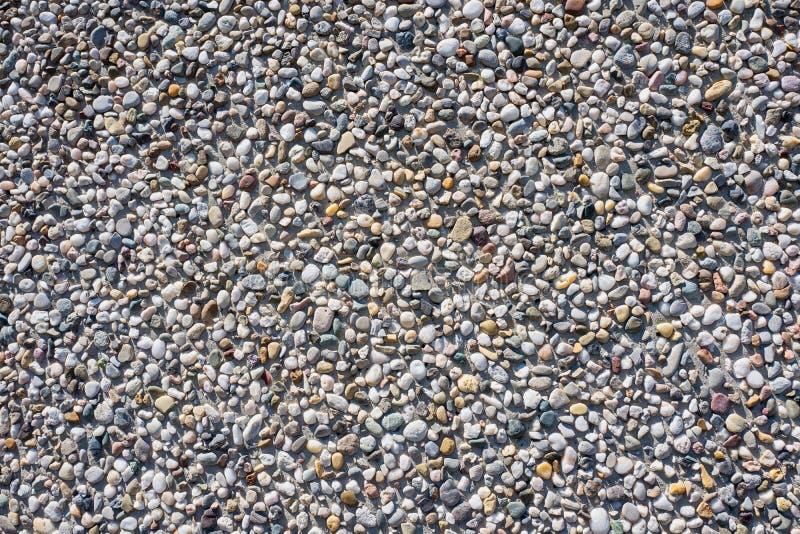 Muro de cimento com os seixos no close-up imagem de stock royalty free