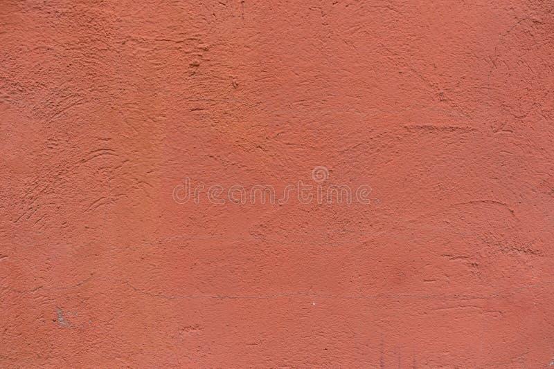 Muro de cimento pintado vermelho para a textura ou o fundo imagens de stock