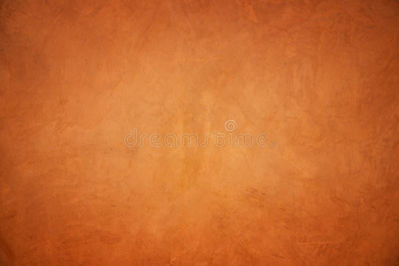 Muro di cemento arancio di lerciume strutturato e fondo immagine stock
