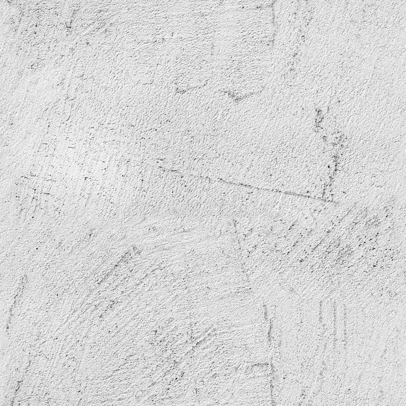 Muro di cemento grigio con il modello in rilievo dello stucco fotografie stock libere da diritti