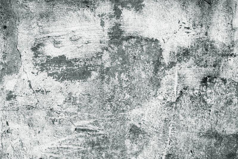 Muro di cemento grigio e bianco Superficie ruvida sporca misera Calce, vecchio stucco Struttura del cemento, fondo astratto immagini stock