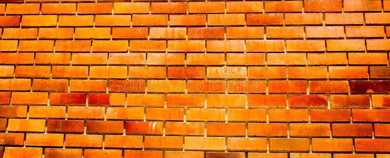 Muro di mattoni arancio antico di colore per fondo fotografia stock