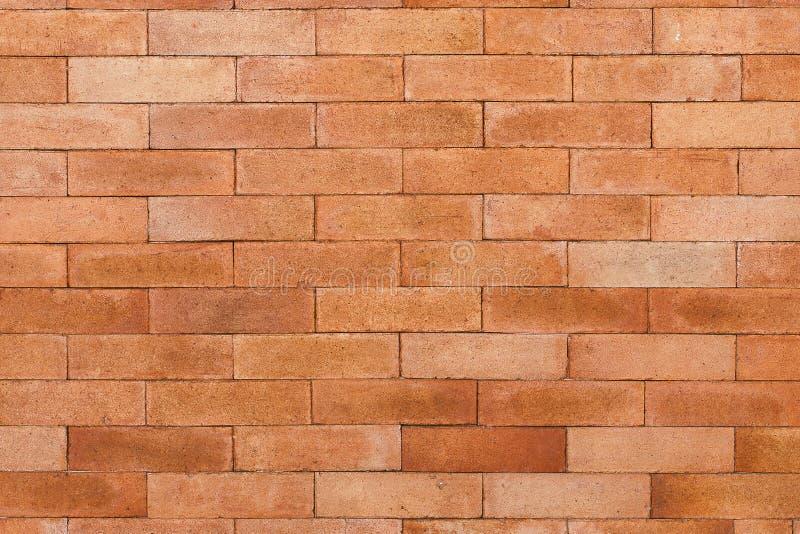 Muro di mattoni arancio per il modello immagine stock