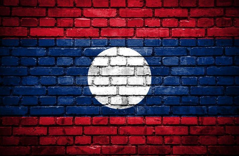 Muro di mattoni con la bandiera dipinta del Laos royalty illustrazione gratis
