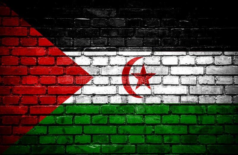 Muro di mattoni con la bandiera dipinta del Sahara occidentale illustrazione di stock
