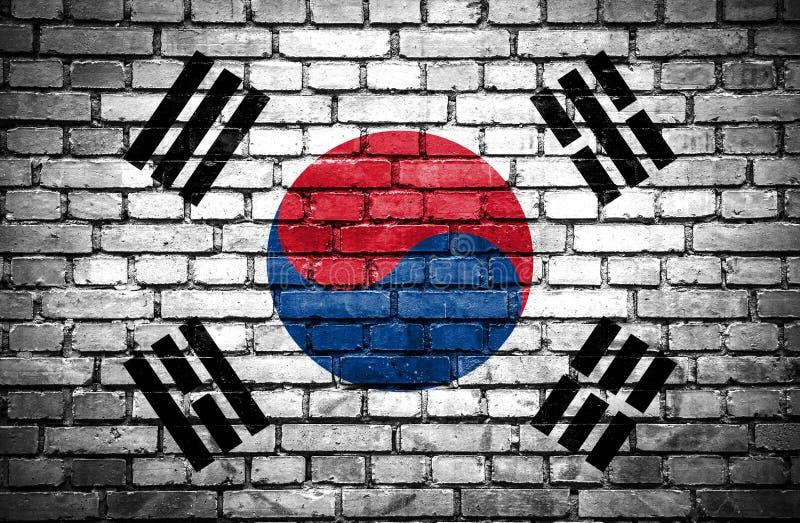 Muro di mattoni con la bandiera dipinta della Corea del Sud royalty illustrazione gratis