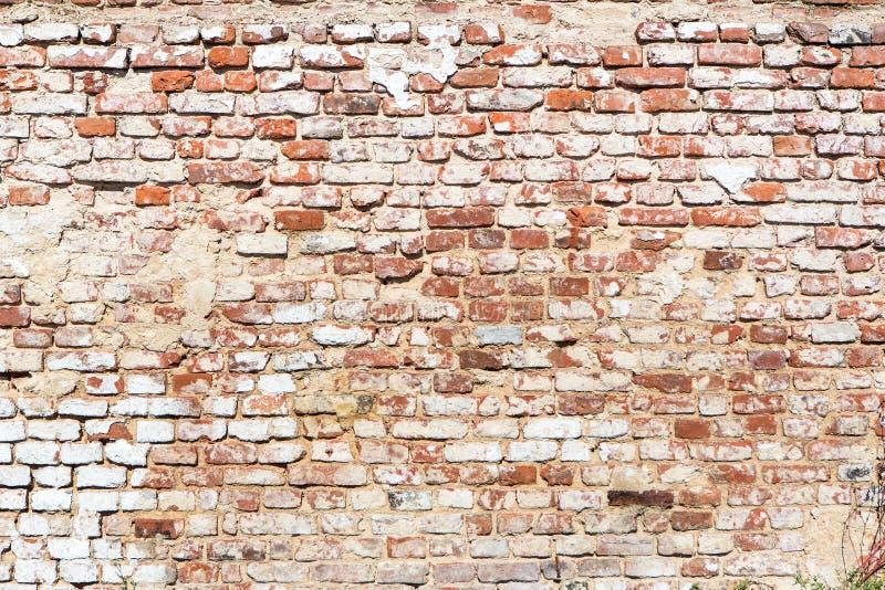 Muro di mattoni con lo sguardo d'annata immagini stock