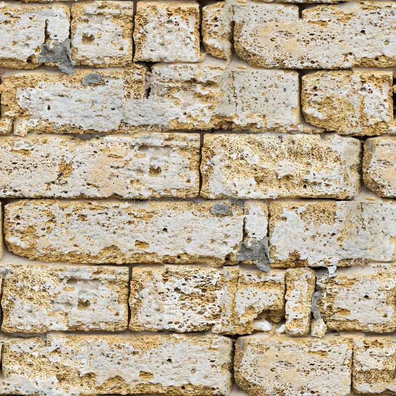 Muro di mattoni dell'arenaria senza cuciture. fotografia stock libera da diritti