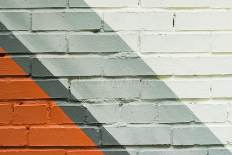 Muro di mattoni di Graffity, dettaglio molto piccolo Primo piano urbano astratto di progettazione di arte della via Cultura urban fotografie stock