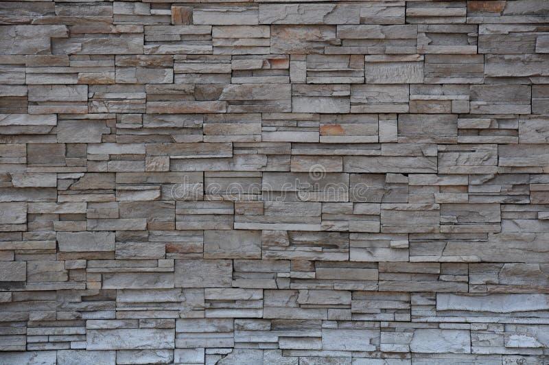 Muro di mattoni di pietra, parete di pietra del mattone moderno immagine stock libera da diritti
