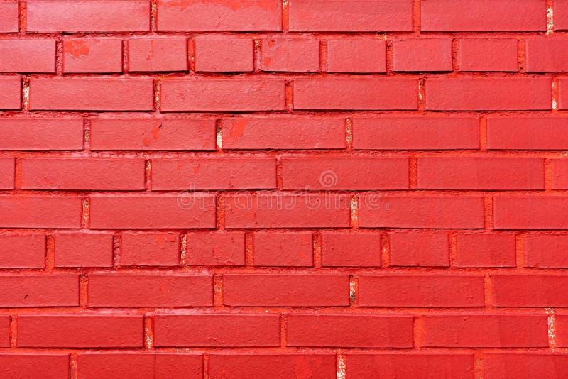 Muro di mattoni dipinto rosso Struttura Fondo fotografia stock
