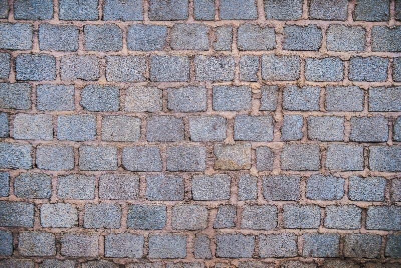 Muro di mattoni Fondo astratto con i mattoni immagini stock
