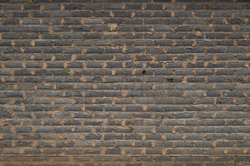 Muro di mattoni nero grungy sudicio fotografie stock libere da diritti