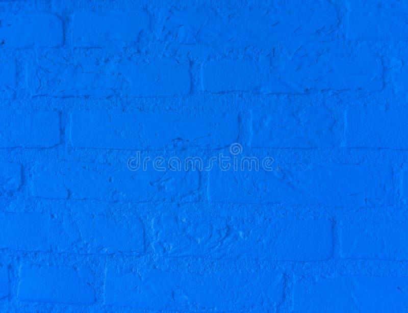 Muro di mattoni di pietra blu al neon moderno con i grandi mattoni vicini sul modello del fondo immagine stock