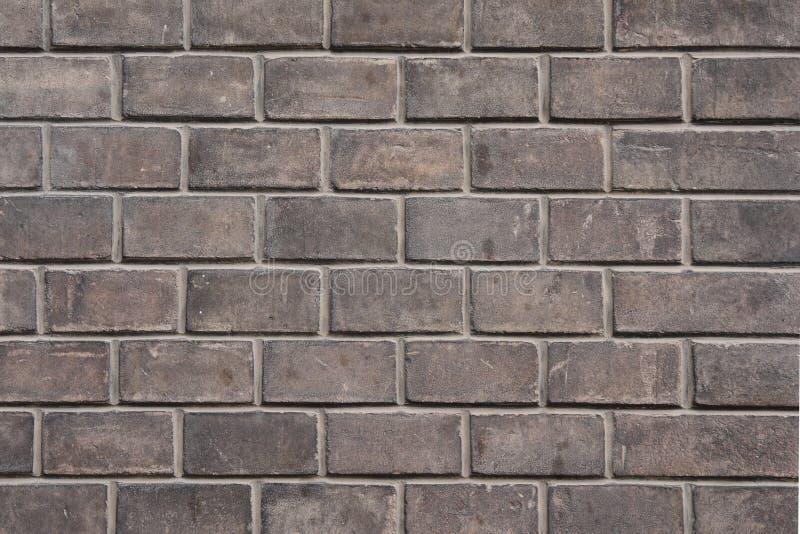 Muro di mattoni sporco grigio fotografia stock