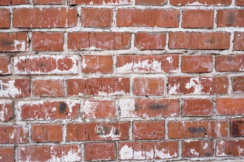 Muro di mattoni, vecchia struttura dei blocchi di pietra rossi Fondo immagine stock