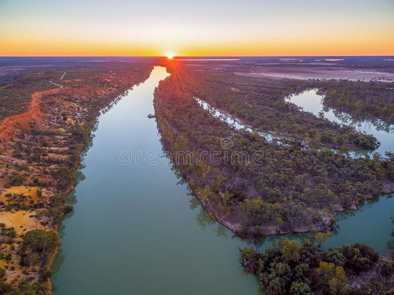 Murray River flowing to the horizon at beautiful sunset. Murray River flowing to the horizon at beautiful sunset - aerial landscape royalty free stock images