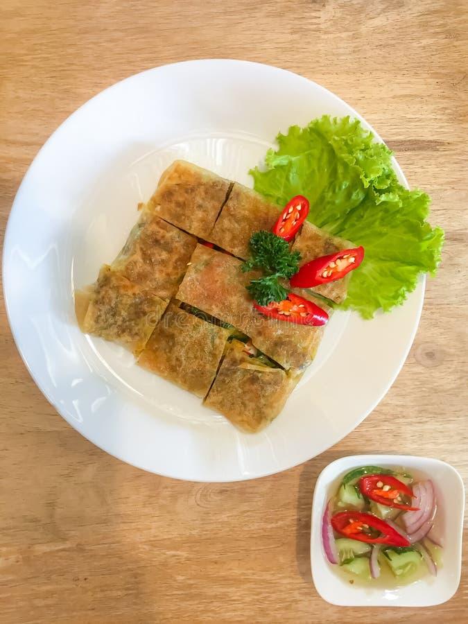 Murtabak roti with Thai Cucumber Relish.  stock image