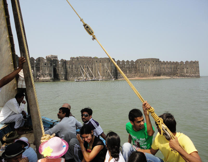 Murud Janjira fort, Alibag India. Murud-Janjira / India - April 04, 2017 - A group of people travelling from the boat in to the sea towards Murud Janjira Fort royalty free stock photos