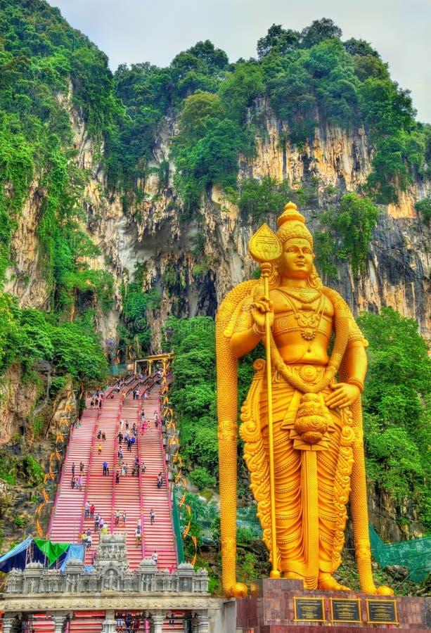 Murugan最高的雕象,一个印度神,在黑风洞-吉隆坡入口,马来西亚 免版税库存照片