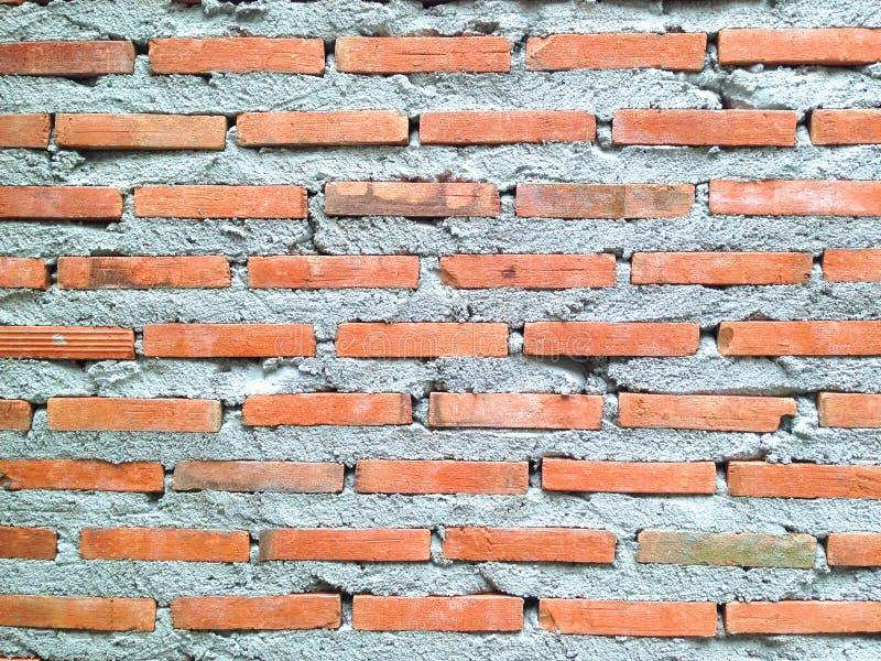 Murverk som bygger en vägg vägg för bakgrundstegelstenred tegelstentapet fotografering för bildbyråer