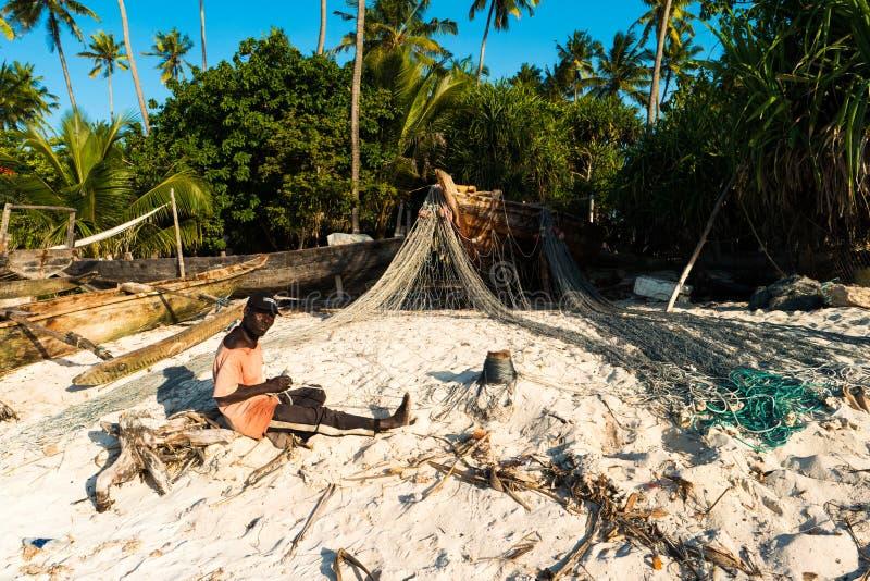 Murzyn Zanzibar, pracuje na sieciach zdjęcie royalty free