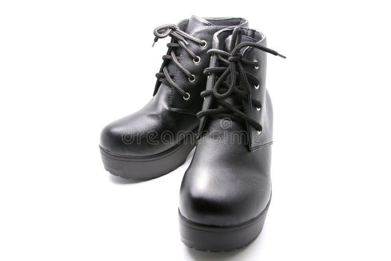 Murzynek szpilek buty na odosobnionym białym tle obraz royalty free