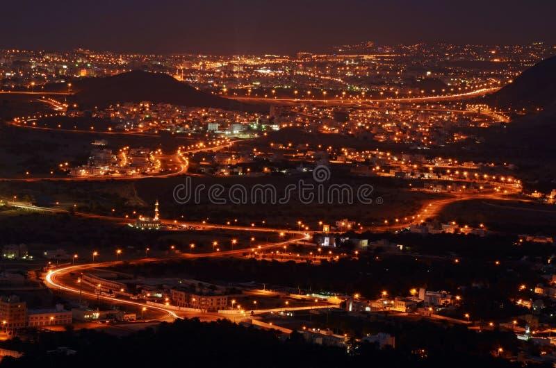 Muscateldruifstad in de nacht, Oman stock foto