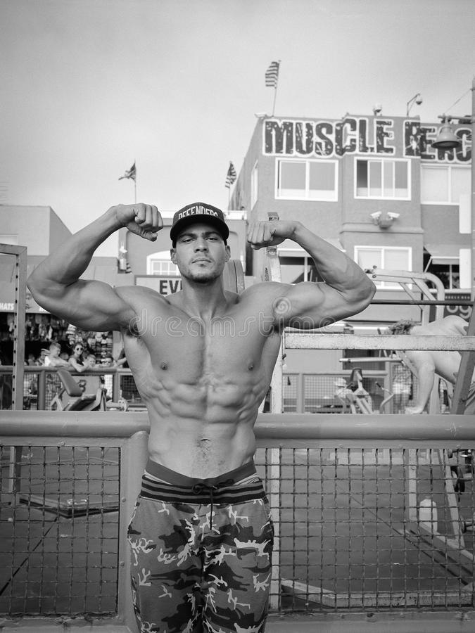 Muscle Beach bodybuilder flexing, black and white stock photos
