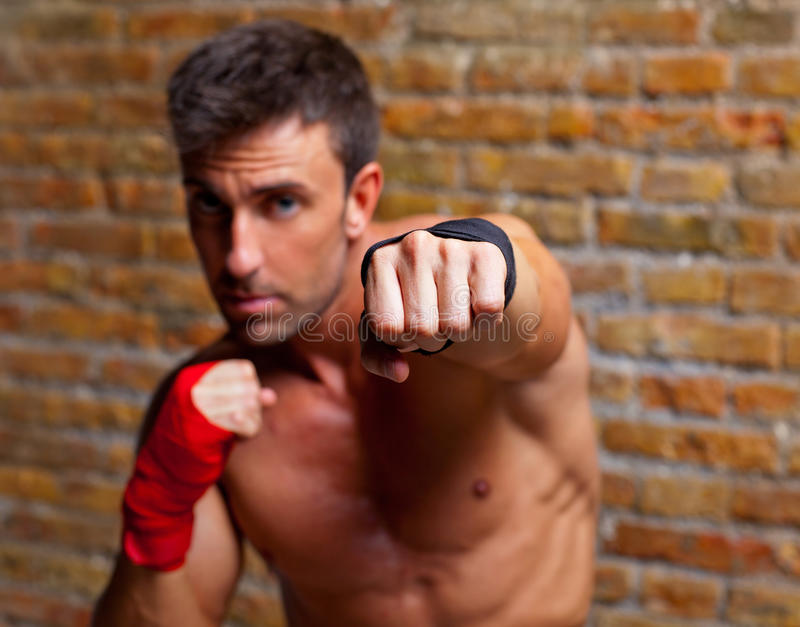 Muscle Boxer Shaped Man Fist To Camera Stock Photo