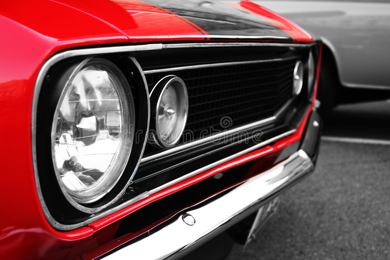 Muscle car. Stylish American muscle car captured at sunset royalty free stock photos