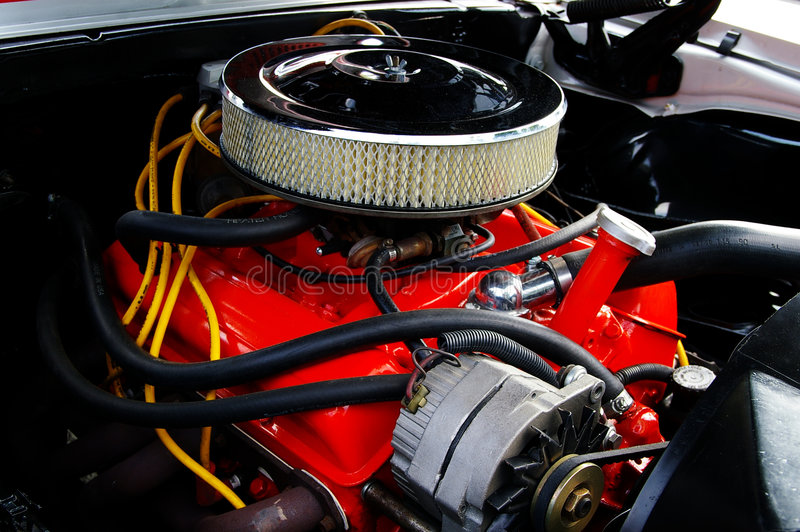 Muscle car engine. Red vintage muscle-car engine with chrome air-filter royalty free stock photography