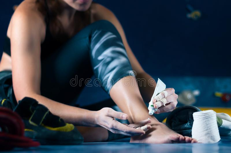Muscle female woman climbing bouldering in training hall stock image