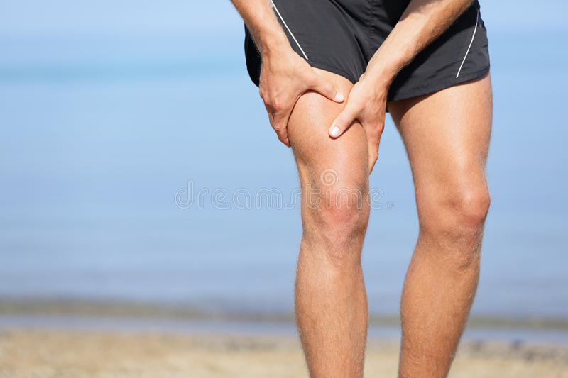 Muscle injury. Man with sprain thigh muscles stock photos
