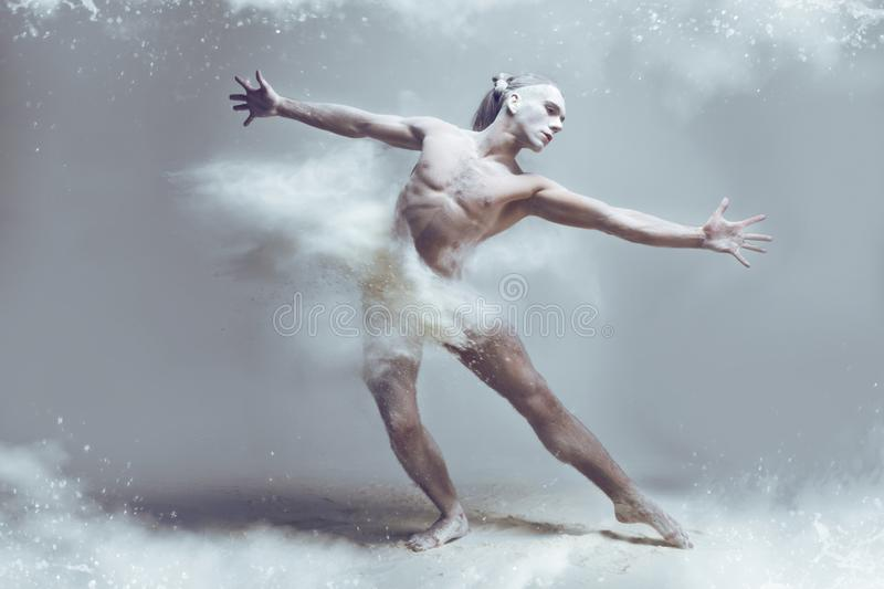 Muscle man dancer in dust / fog royalty free stock image