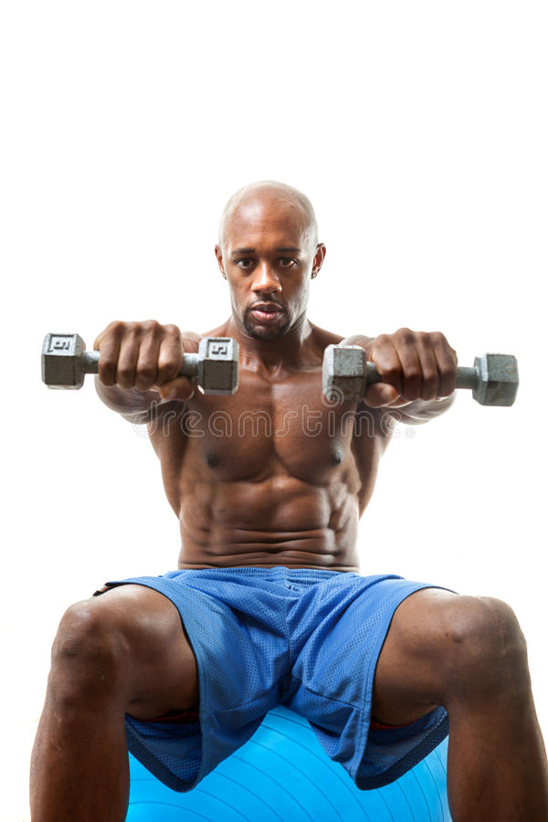 Muscle Man Holding Dumbells royalty free stock image