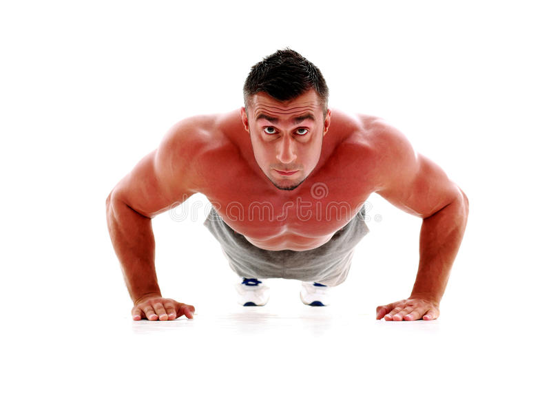 Muscle man making push ups in studio royalty free stock image