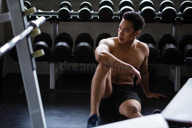 Muscle man rest after dumbbell exercise stock photos