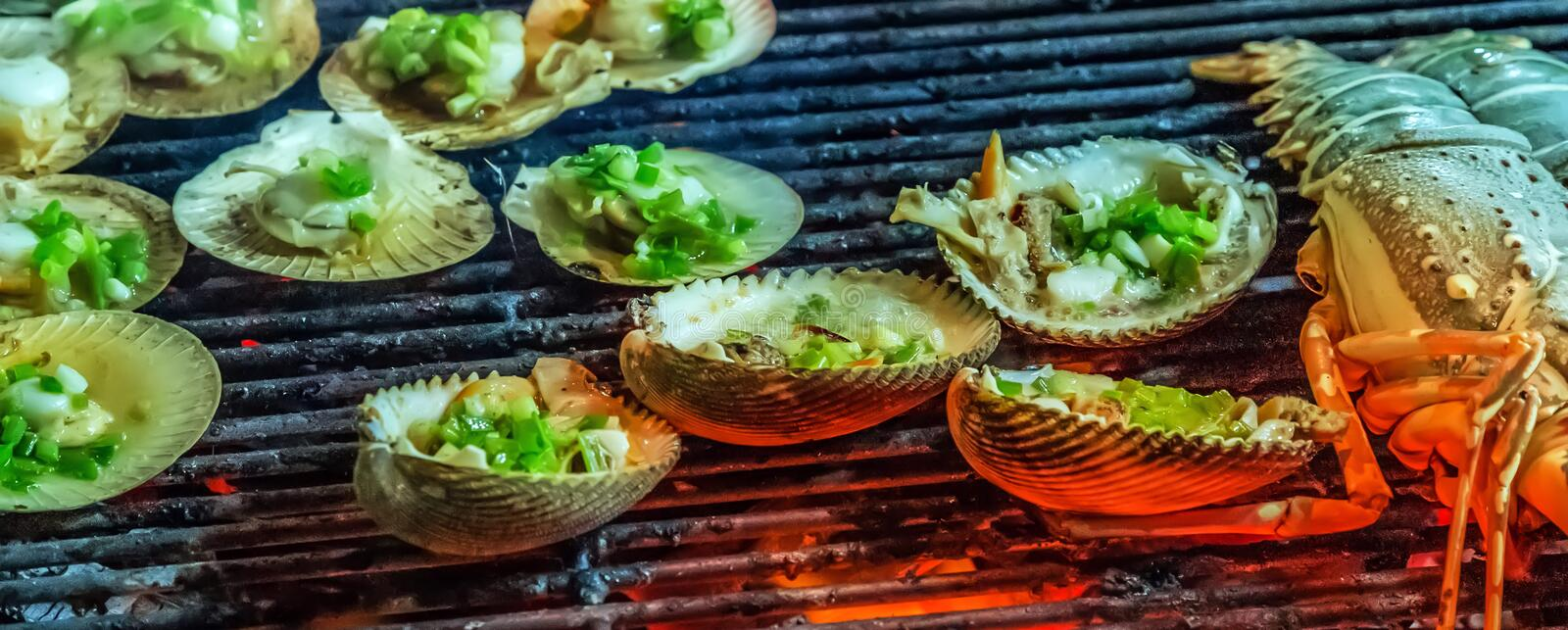 Muscle mussel oyster grilling steamed barbecue. Cooking bbq Food Background royalty free stock photo