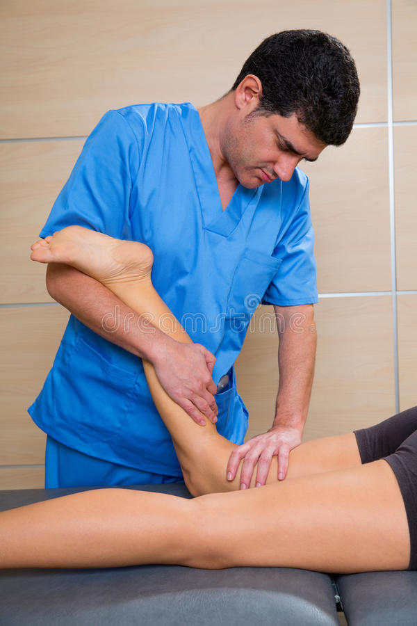 Muscle power therapy on woman leg knee stock images