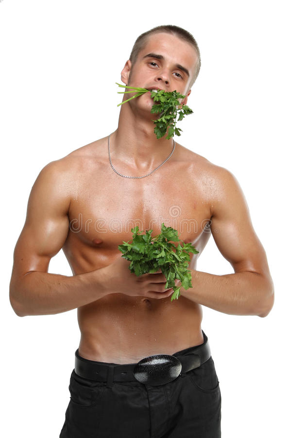 Muscle Wet Naked Young Man Eating The Parsley Royalty Free Stock Image