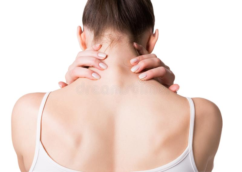 Muscle spasm, neck, trapezoid and shoulders pain. Female back in white top. Woman put her fingers on sore spots stock images