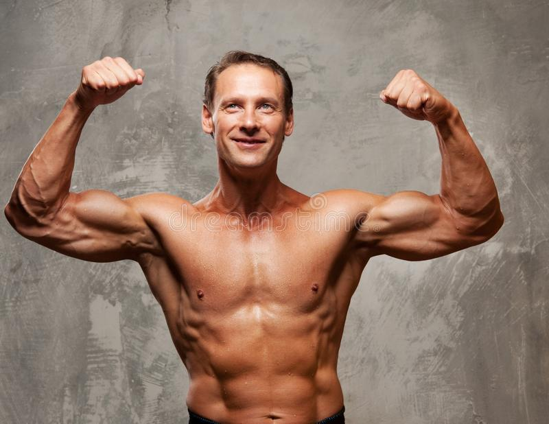 Download Muscle Sportsman On A Grey Background Royalty Free Stock Image - Image: 25165916