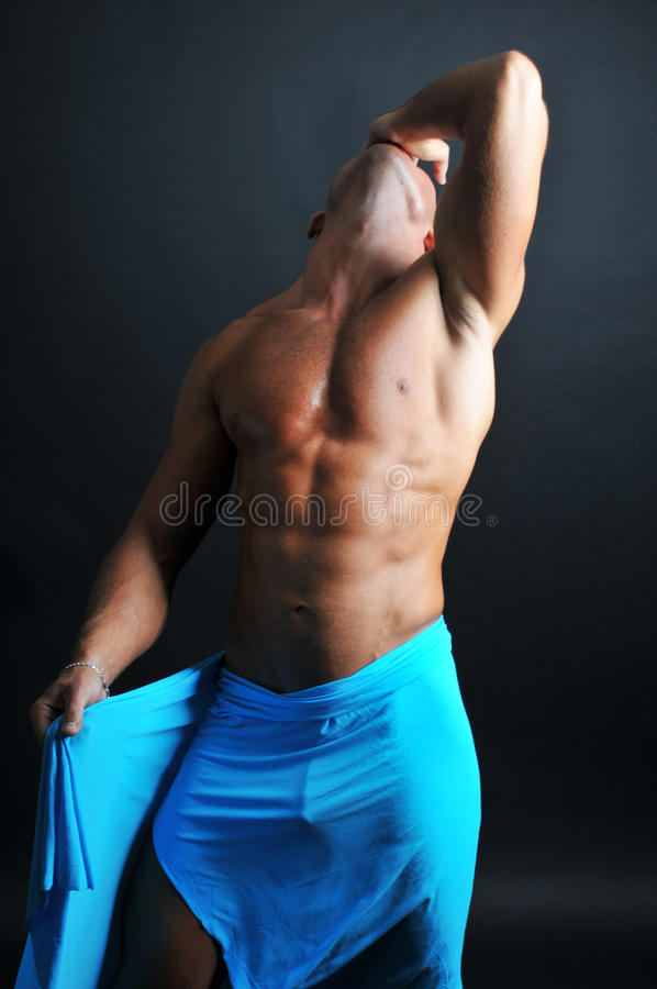 Muscled model. With a blue textile royalty free stock photos