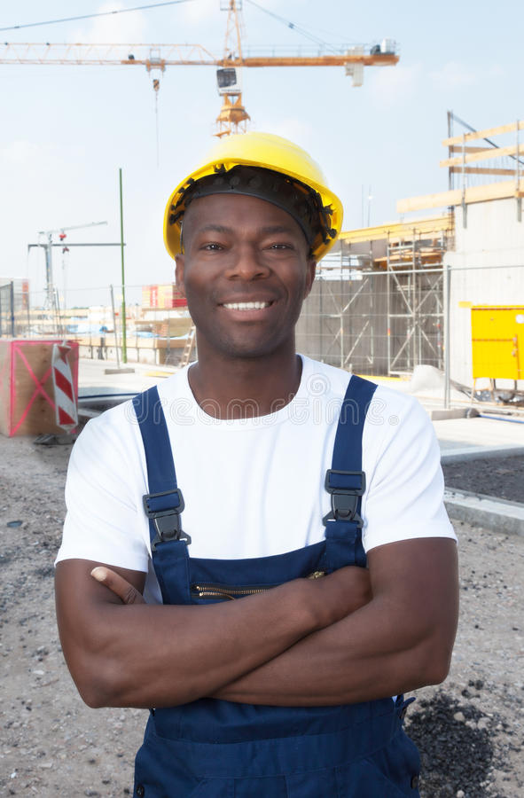 Muscular african american construction worker at building site royalty free stock images