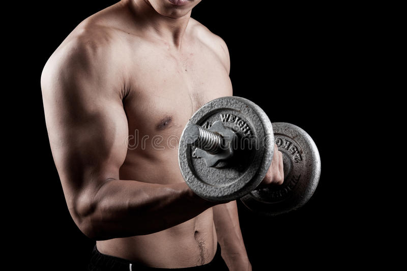 Muscular Asian man with dumbbell royalty free stock photos