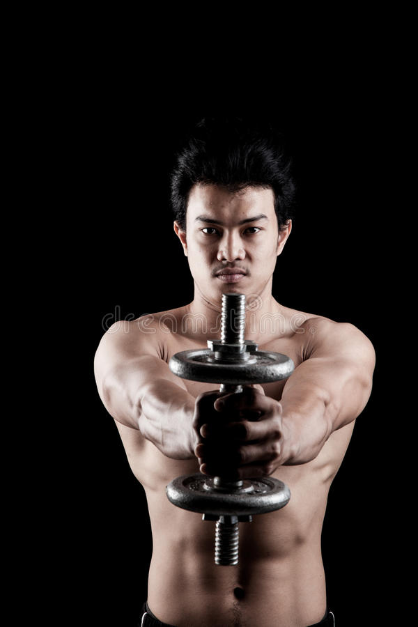 Muscular Asian man with dumbbell royalty free stock photo