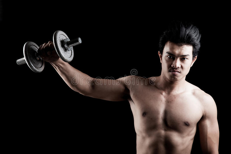 Muscular Asian man with dumbbell royalty free stock images